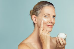 woman with anti-aging product